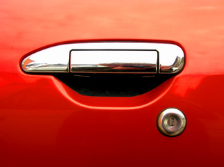 car silver handle on red background