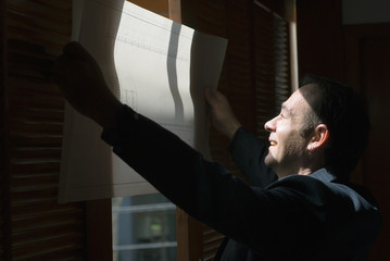 Man Reviewing Plans