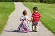 Children walking together on a sidewalk
