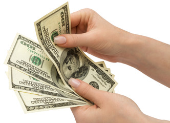 US Dollars in woman's hand, isolated with clipping path