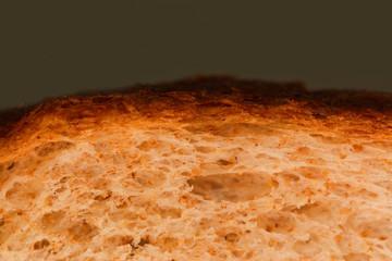 slice of grain Brown Bread with crust over dark gray