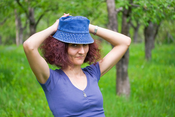 Woman with cap in an orchard