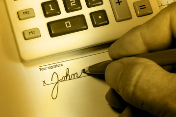 John Doe Signs His Name