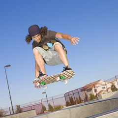 Skateboard tricks at a skateboard park