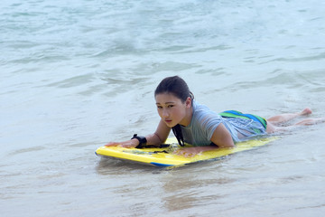 girl floating on boogy board