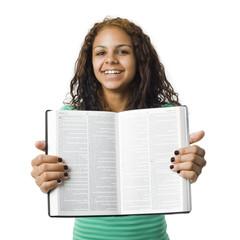 Girl holds bible