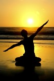 Yoga meditation posture at sunset poster
