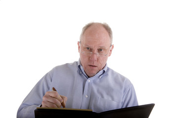 Old Guy in Blue Shirt Taking Notes