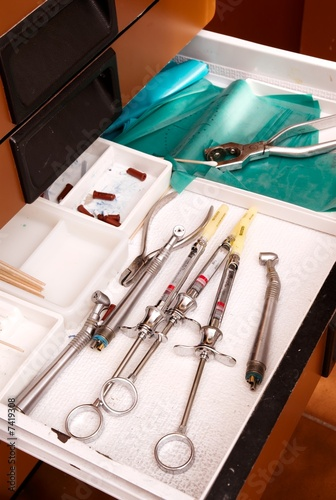 A dentists tools in a drawyer for dental work on patient.