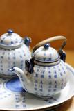 Asian pottery tea set. poster