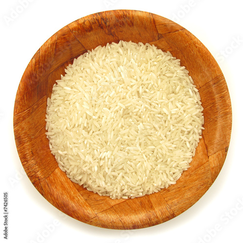 Rice white in wooden dish isolated on