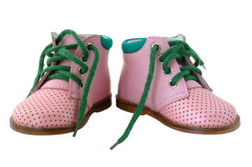 Pink leather baby's boots with green shoe-laces.