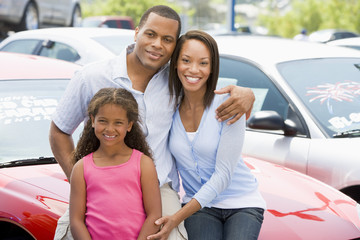 Family on new car lot