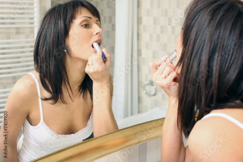 Beautiful woman doing make up