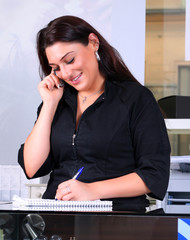 Receptionist taking a note
