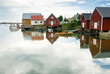 Small private harbor reflecting timber houses