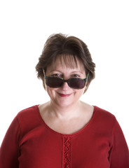 Woman in Red Looking Over Sunglasses