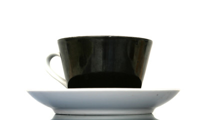 The black cup with fragrant coffee costs on a table