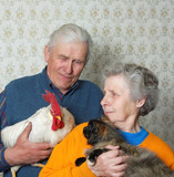 grandfather with rooster and grandmother with pussy-cat poster