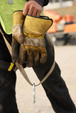 Construction Worker Takes Off Gloves After A Days Work poster