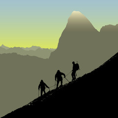 Three climbers descending ridge at sunrise