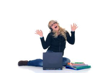 Teen listening music on laptop
