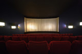 Rows of chairs in a cinema with the curtain drawn poster