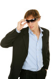 Young Businessman Removes Sunglasses poster