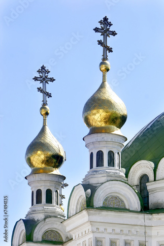 Orthodox crosses on blue sky background