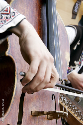 close up of playing contrabass