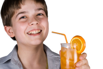 The boy with a glass of orange juice
