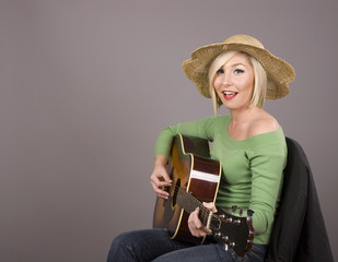 Blonde Playing Guitar and Singing
