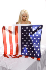 beautiful blond sillohetted against the american flag