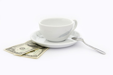 Empty cup of coffee with two dollars tip
