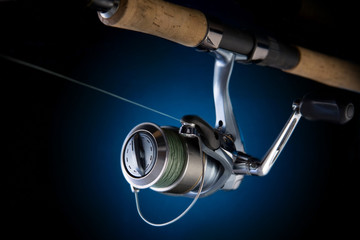 Fishing reel, mounted on a fishing rod