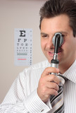 Optometrist, eye doctor with opthalmoscope poster