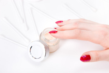 Woman hand with body cream