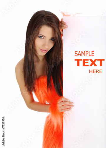 smiling girl in orange costume holding a blank billboard.