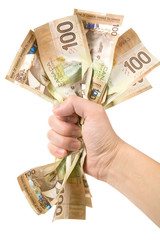 a hand full of canadian dollars