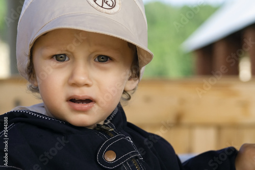boy in a cap with a peak