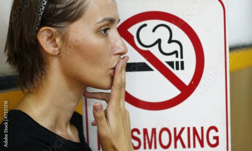 Lady smoking a non-smoking panel