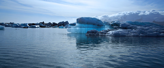 Panoramic view of a beautiful blue iceberg
