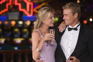 Couple celebrating in casino