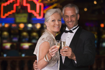 Mature couple celebrating in casino