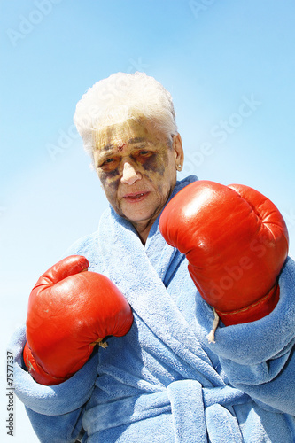 Senior woman and red boxing gloves