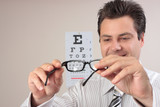 Optometrist examining eye glasses  poster