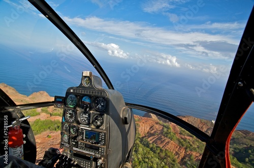 Helicopter, tropical ocean view from cockpit - 7578558