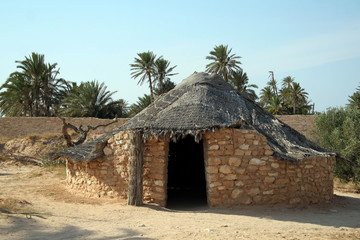 Old house in Africa made from mud and rocks.
