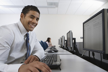 Man sitting at desk in front of computer