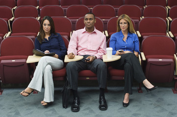 Business people sitting in auditorium